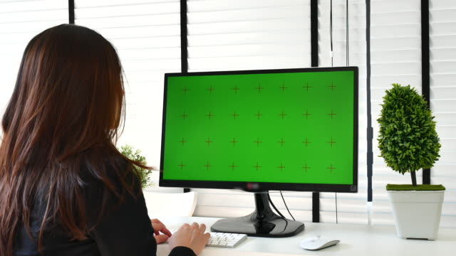 businesswoman using computer with green screen, chroma key - desktop pc stock videos & royalty-free footage