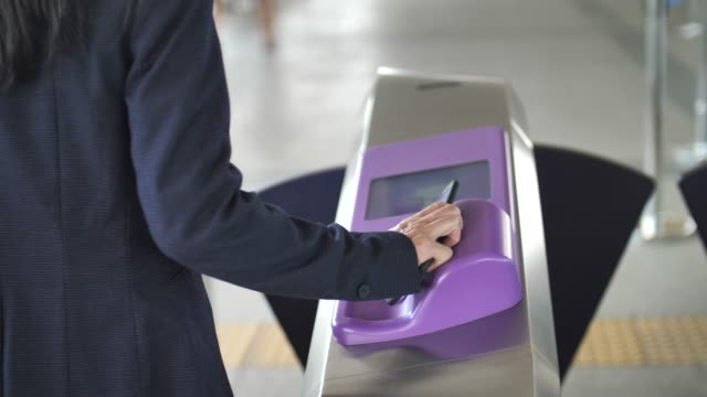 Businesswoman Using Contactless payment on train Station