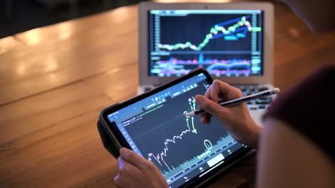 businesswoman using digital tablet for stock market data analyzing in trading - graph stock videos & royalty-free footage