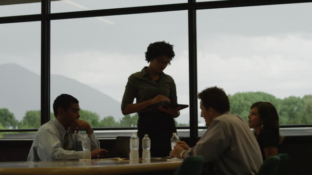 MS ZI Businesswoman using digital tablet in presentation / Orem, Utah, USA