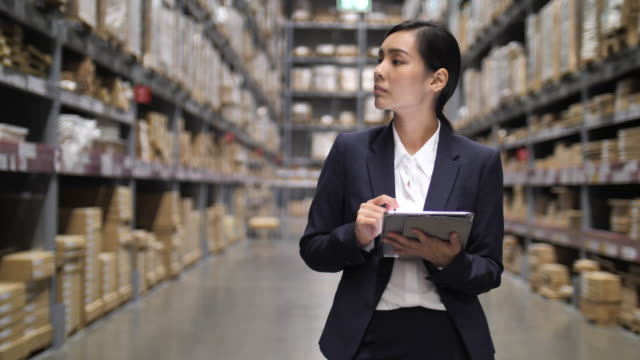 businesswoman using digital tablet in warehouse - freight transportation stock videos & royalty-free footage