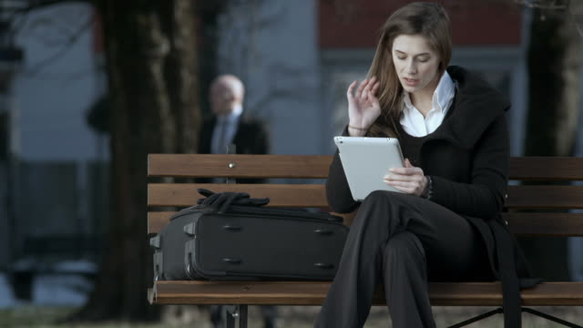HD: Businesswoman Using Digital Tablet On Bus Station
