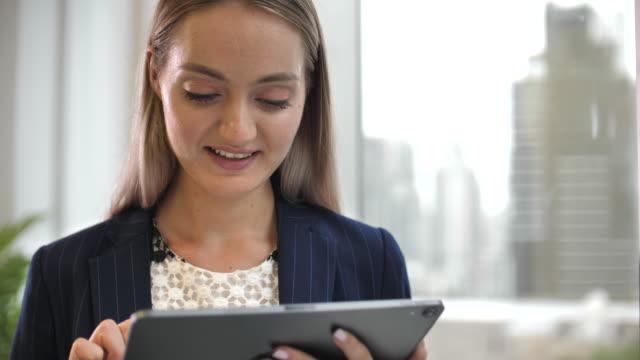 businesswoman using digital tablet - using digital tablet stock videos & royalty-free footage