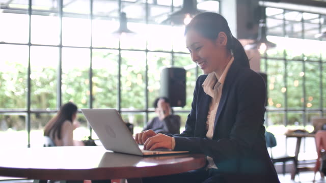 businesswoman using laptop in cafe - ladder of success stock videos & royalty-free footage