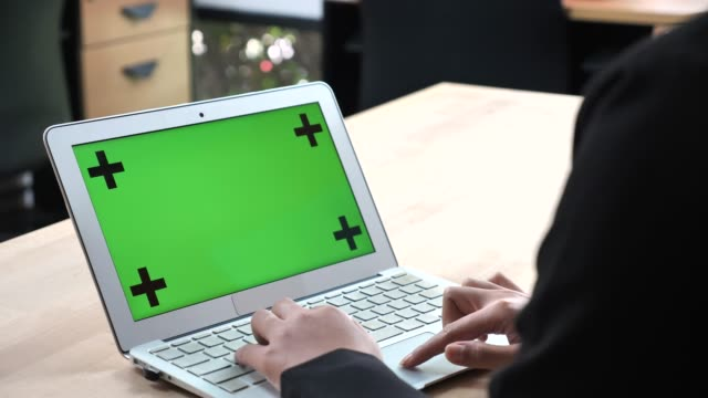 businesswoman using laptop with green screen - template stock videos & royalty-free footage