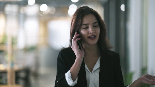 businesswoman using phone in office - guest stock videos & royalty-free footage