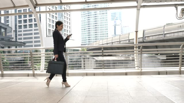 businesswoman using phone touchscreen commuting to work - electronic organizer stock videos and b-roll footage