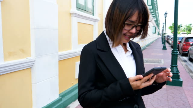 Businesswoman using smart phone in Bangkok