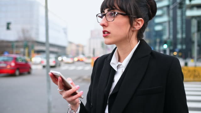 businesswoman using smart phone in city - bangs stock videos and b-roll footage