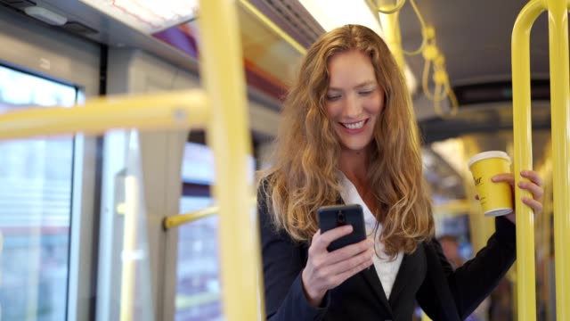 businesswoman using smart phone in the train - content stock videos & royalty-free footage