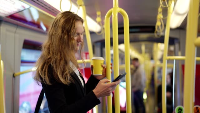 businesswoman using smart phone in the train - contented emotion stock videos & royalty-free footage