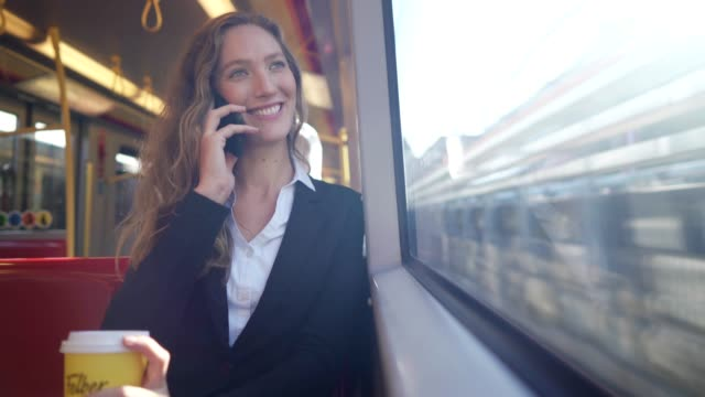 businesswoman using smart phone in the train - public transport stock videos & royalty-free footage