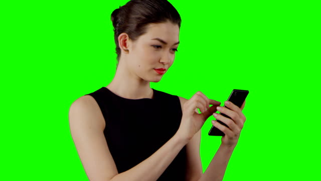 businesswoman using smart phone on a green screen - pointing stock videos & royalty-free footage
