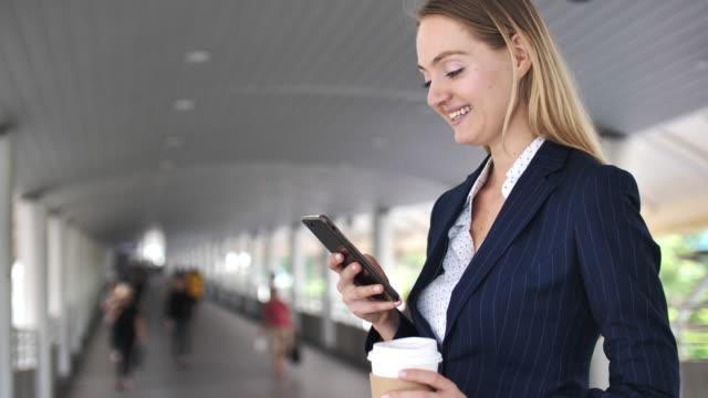 businesswoman using smart phone - sending stock videos & royalty-free footage
