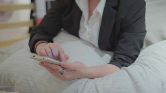 businesswoman using smartphone - profile view stock videos & royalty-free footage