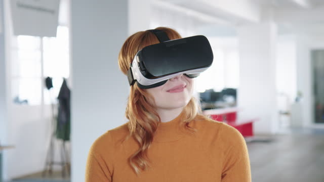 businesswoman using vr headset - wearable computer stock videos & royalty-free footage