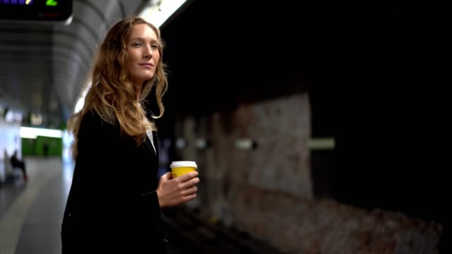 businesswoman waiting for a train - underground station platform stock videos & royalty-free footage