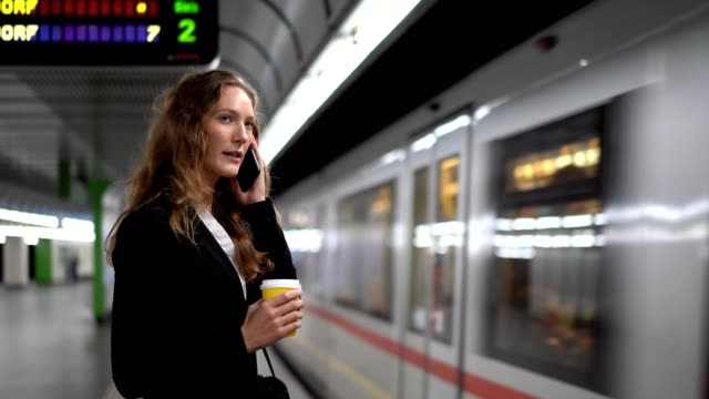 businesswoman waiting for a train - austria stock videos & royalty-free footage