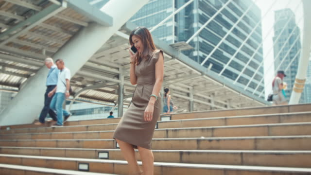 Businesswoman walking and talking on mobile phone