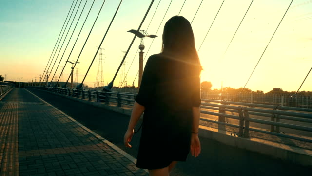 businesswoman walking at sunset - full suit stock videos & royalty-free footage