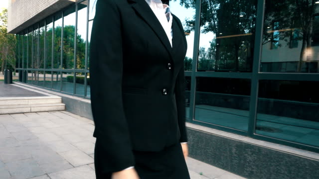businesswoman walking between office buildings - chief executive officer stock videos & royalty-free footage