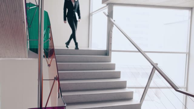 Businesswoman walking down the stairs