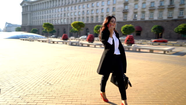 Businesswoman walking in the city center.