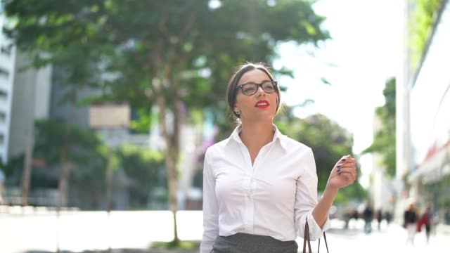 businesswoman walking in the city streets - pavement stock videos & royalty-free footage