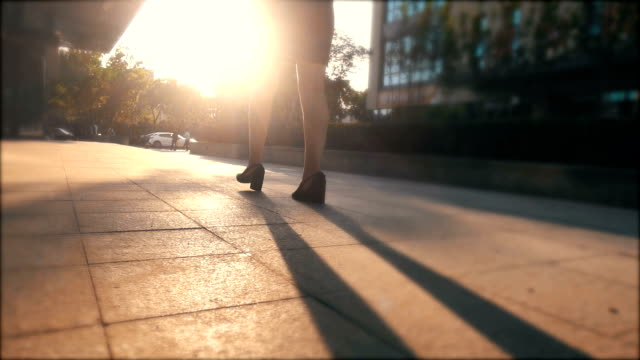 businesswoman walking in the urban street at sunset - high heels stock videos & royalty-free footage