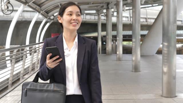 businesswoman walking to work - electronic organiser stock videos & royalty-free footage