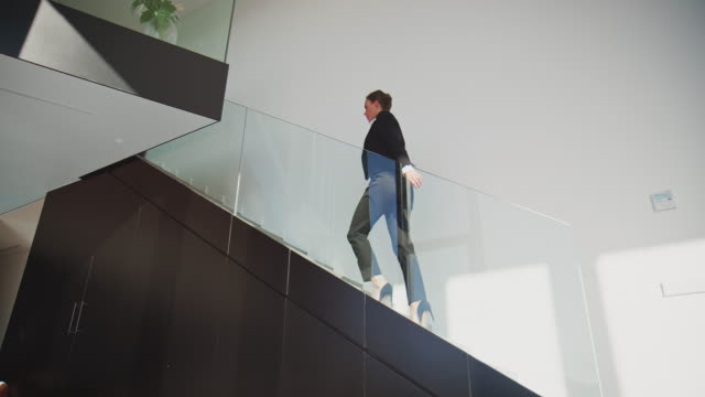 businesswoman walking up on steps at home - steps and staircases stock videos & royalty-free footage