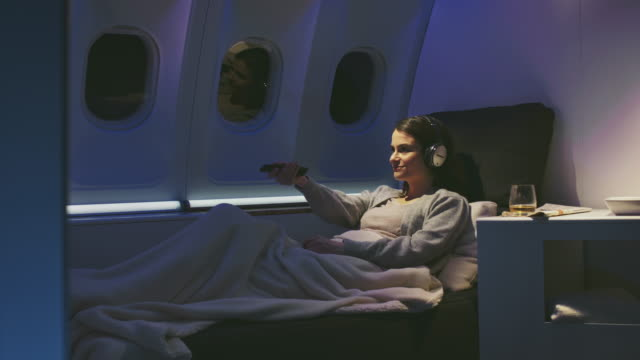 businesswoman watching movie in private airplane - watch stock videos & royalty-free footage