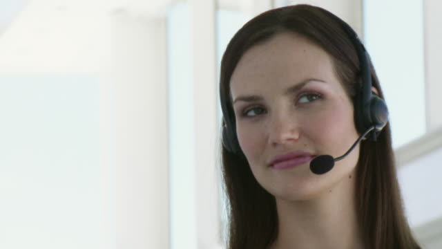 cu businesswoman wearing headset in office / cape town, south africa - sideways glance stock videos & royalty-free footage