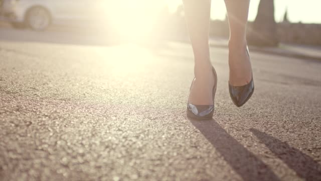 businesswoman wearing heels walking in the city. close up on legs - dress shoe stock videos and b-roll footage