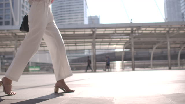 businesswoman wearing heels walking - low angle view stock videos & royalty-free footage