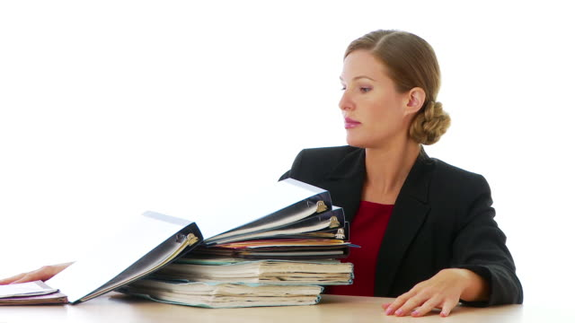 Businesswoman with a pile of documents