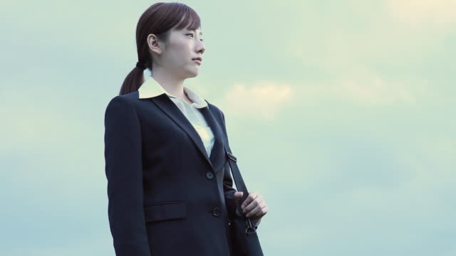 ms businesswoman with airplane in flight in background / odaiba, tokyo, japan - only women stock videos & royalty-free footage
