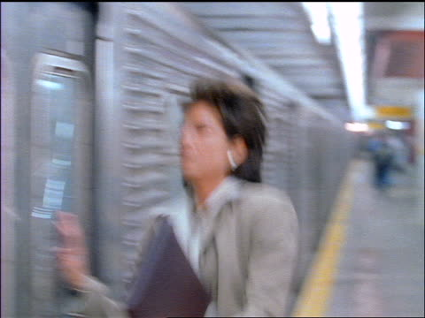 Businesswoman with eyeglasses running to catch subway train + misses it / NYC