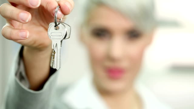 businesswoman with keys - house key stock videos & royalty-free footage