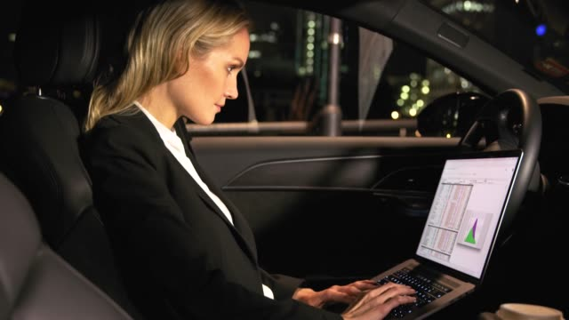 businesswoman with laptop and coffee in car - driver's seat stock videos and b-roll footage