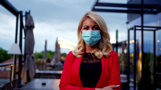 businesswoman with protective face mask during covid-19 pandemic - business finance and industry stock videos & royalty-free footage