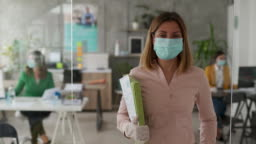Businesswoman with protective face mask in office