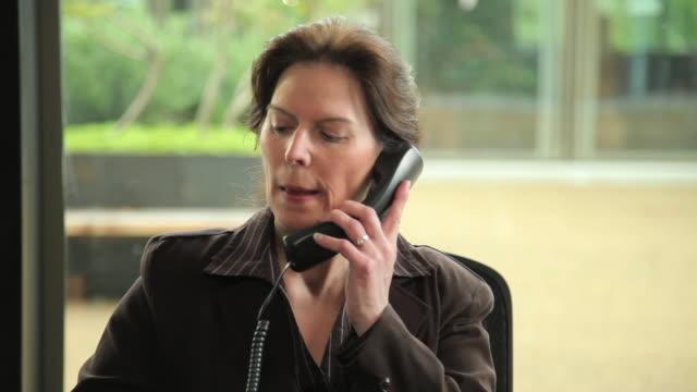 CU TD TU Businesswoman working at desk / Portland, Oregon, USA