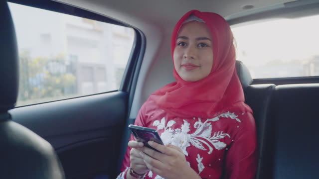 businesswoman working at smartphone in back seat of crowdsourced taxi. - passenger seat stock videos & royalty-free footage
