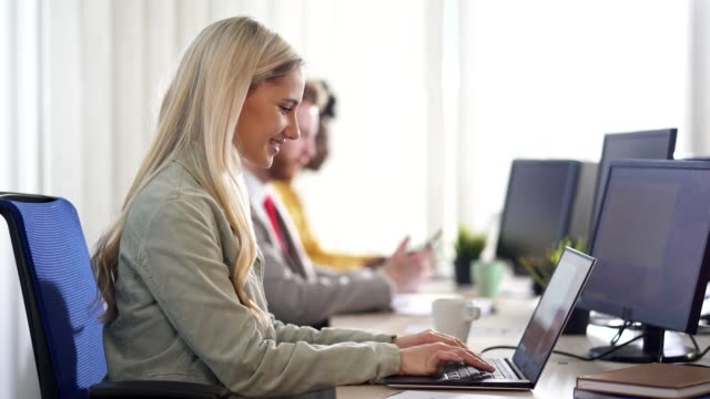 businesswoman working in the office - coworker stock videos & royalty-free footage