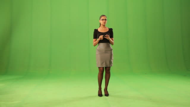 businesswoman working on a mobile phone  - alphachannel stock-videos und b-roll-filmmaterial