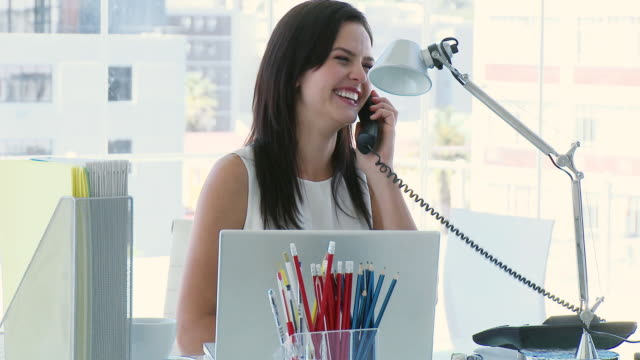 ms businesswoman working on laptop and answering phone / cape town, south africa - see other clips from this shoot 1790 stock videos & royalty-free footage