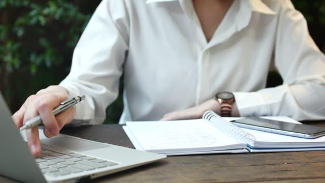 Businesswoman working on laptop outdoor