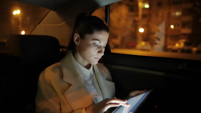 businesswoman working on the tablet in the car. - business travel stock videos & royalty-free footage