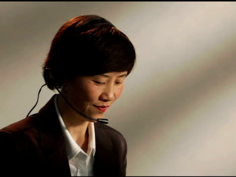 Businesswoman working with headset